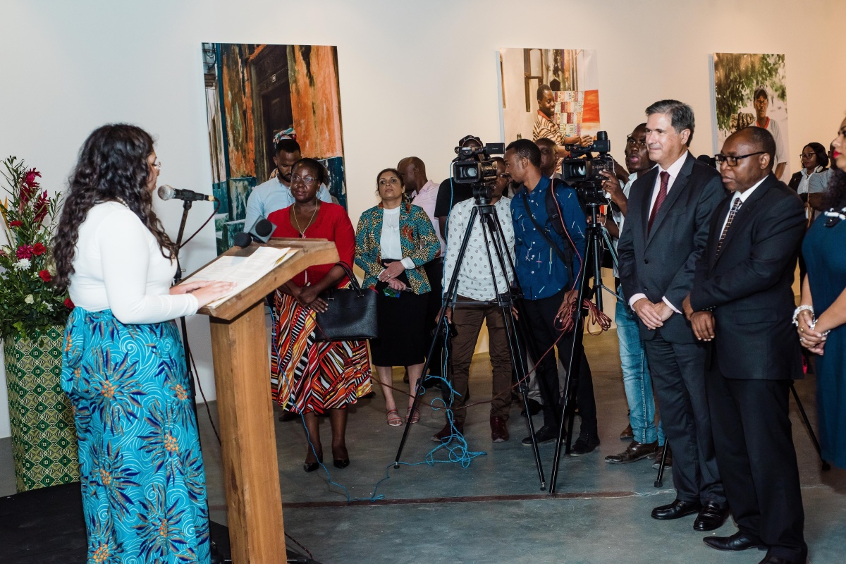 Rania speaks at the photography exhibition